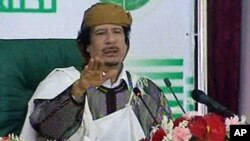 Image taken from Libyan state television broadcast shows Libyan leader Moammar Gadhafi addressing supporters and foreign media in Tripoli, March 2, 2011