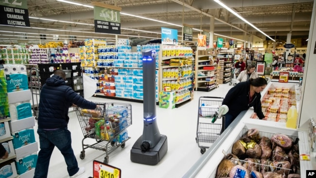 In this Jan. 15, 2019, file photo a robot named Marty cleans the floors at a Giant grocery store in Harrisburg, Pa. (AP Photo/Matt Rourke, File)