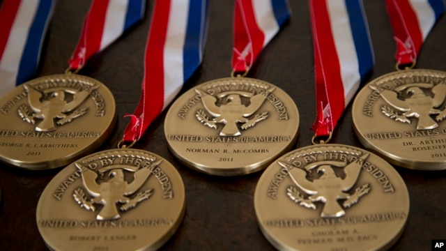 FILE - National Medals of Technology and Innovation are seen in the East Room of the White House in Washington.