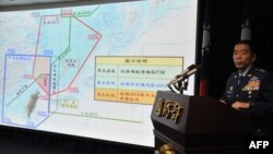 FILE - Air Force Lieutenant General Liu Shou-Jen introduces a map of Air Defense Identification Zone (ADIZ) in the East China Sea during a press conference in Taipei, Taiwan, Dec. 2, 2013. Taiwan said its military planes have made about 30 flights into a part of China's newly declared air defense zone, which overlaps a similar Taiwanese zone.