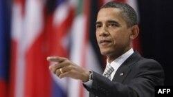 Президент США Барак Обама выступает на пресс-конференции в Лиссабоне.