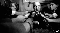 FILE - This Oct. 21, 1971 file photo shows Pablo Neruda, poet and then Chilean ambassador to France, talking with reporters in Paris after being named the 1971 Nobel Prize for Literature. Neruda died in 1973.