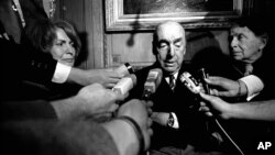 FILE - This Oct. 21, 1971, photo shows Pablo Neruda, poet and then Chilean ambassador to France, talking with reporters in Paris after being named winner of the 1971 Nobel Prize for Literature.