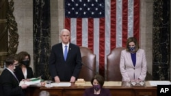 Vice President Mike Pence and Speaker of the House Nancy Pelosi, D-Calif., read the final certification of Electoral College votes cast in November's presidential election during a joint session of Congress after working through the night, at the Capitol