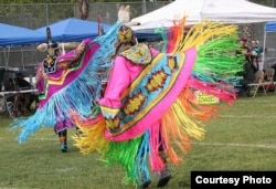 This photo shows Fancy Shawl dancers performing at a pow wow in San Jose, Cal., date unknown.