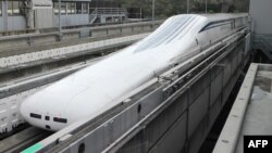 The Central Japan Railway Co.'s seven-car 'magnetic levitation' or maglev train returns to the station after setting a new world speed record in a test run near Mount Fuji, April 21, 2015.