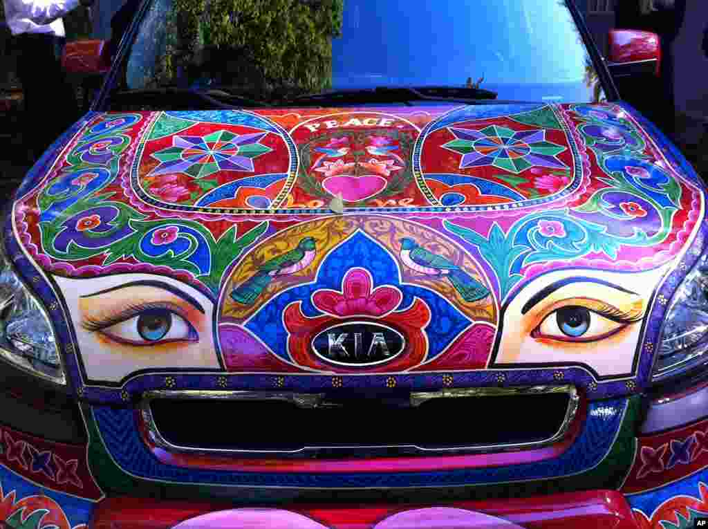 Traditional Pakistani patterns are incorporated onto an American car.