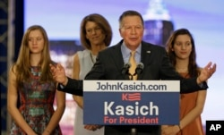 Republican presidential candidate Ohio Gov. John Kasich speaks at his presidential primary election rally in Berea, Ohio, March 15, 2016. His wife, Karen, and twin daughters, Emma, left, and Reese listen.