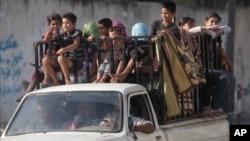 2014年8月27日,加沙市的巴勒斯坦居民回到自己的住宅