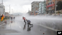FILE - Nepalese police use water cannon to disperse Hindu protestors after they tried to enter a restricted area near the Constituent Assembly hall in Kathmandu, Nepal, Sept 14, 2015.