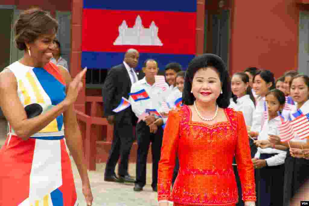 Michelle Obama arrived with her Cambodian counterpart, Bun Rany, at Hun Sen Prasat Bakong Hight School, outside Siem Reap, March 21, 2015..