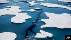 Sea ice breaks apart as the Finnish icebreaker MSV Nordica traverses the Northwest Passage through the Victoria Strait in the Canadian Arctic Archipelago in a Friday, July 21, 2017 file photo. (AP Photo/David Goldman, File)