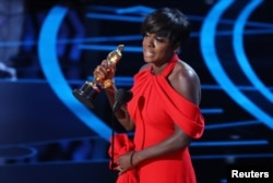 """Viola Davis accepts the award for Best Supporting Actress for her role in """"Fences."""""""