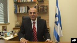 Shaul Mofaz, head of the centrist Kadima party, poses for a photo in his office at parliament in Jerusalem, before he was sworn in as a cabinet minister.