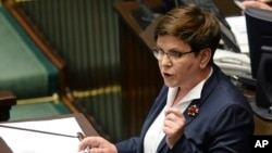 Critics denounce Polish Prime Minister Beata Szydlofor for making comments during a memorial observance at Auschwitz, June 14, 2015, that appeared to defend her tough anti-migrant policies, saying her words were inappropriate given the location.