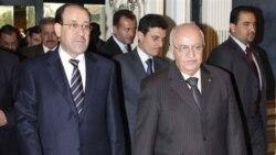 راست: محمد ناجی العُطری، نخست وزیر سوریه به همراه همتای عراقی اش نوری المالکی
