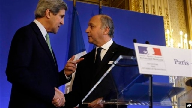 U.S. Secretary of State John Kerry, left, shakes hands with French Minister of Foreign Affairs Laurent Fabius, Paris, Feb. 27, 2013.