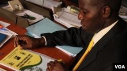 Stephen Masaba of the Uganda Wildlife Authority reviews plans to upgrade Kidepo National Park, Sept. 5, 2013. (Hilary Heuler for VOA)