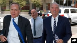 Expelled Arizona House Rep. Don Shooter, right, arrives at court with attorney Tim Nelson, left, June 14, 2018, in Phoenix.