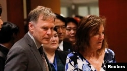FILE - Fred Warmbier, right, and Cindy Warmbier, parents of Otto Warmbier, an American who died last year, days after his release from captivity in North Korea, wait for a meeting Thursday, May 3, 2018, at the United Nations headquarters.