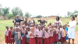 Members of the partnership's board of directors visit a school in Kigali, Rwanda