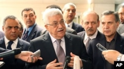 Palestinian Authority President Mahmoud Abbas speaks to the media after meeting with US Secretary of State Hillary Clinton at the State Department in Washington, D.C., 11 Jun 2010