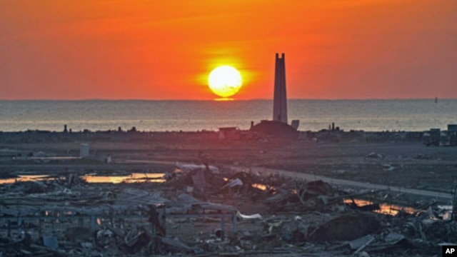 The New Year sunrise lights up an area devastated by the March 2011 tsunami in Kesennuma, Miyagi prefecture, January 1, 2012.