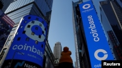 The logo for Coinbase Global Inc, the biggest U.S. cryptocurrency exchange, is displayed on the Nasdaq MarketSite jumbotron and others at Times Square in New York, U.S., April 14, 2021. REUTERS/Shannon Stapleton