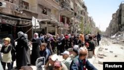 ဆီးရီးယားႏုိင္ငံရဲ႕ၿမိဳ႕ေတာ္နား Yarmouk ဒုကၡသည္စခန္း။