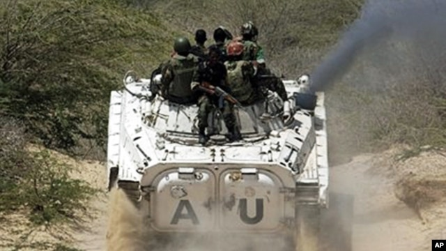 African Union peacekeepers patrol in a tank as they assist Somalia government forces during clashes with insurgents in southern Mogadishu, March 9, 2011
