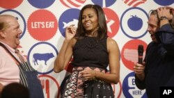 U.S. first lady Michelle Obama participates in a cooking demonstration at the James Beard American Restaurant with Italian and American middle school students in Milan, Italy, June 17, 2015.