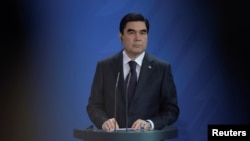 FILE - President of Turkmenistan Kurbanguly Berdymukhamedov attends a news conference in Berlin, Germany, Aug. 29, 2016.