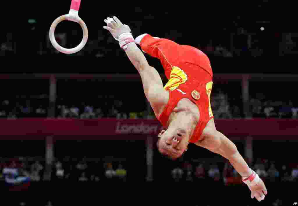Chinese gymnast Chen Yibing performs on the rings during the Artistic Gymnastic men's team final, July 30, 2012.