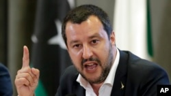 FILE - Italian Interior Minister Matteo Salvini makes a point during a joint press conference with Vice President of Libyan Parliamentary Council Ahmed Maitig, in Rome, July 5, 2018.