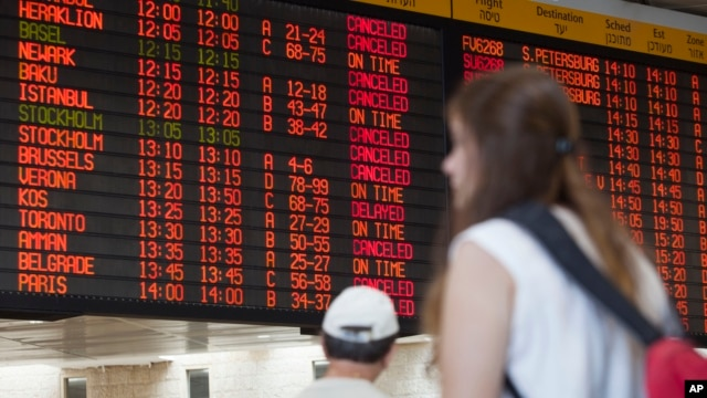 A departure flight board displays various canceled and delayed flights in Ben Gurion International airport a day after the U.S. Federal Aviation Administration imposed a 24-hour restriction on flights to the airport in Tel Aviv, Israel, July 23, 2014.