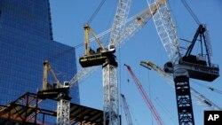 Cranes work at Hudson Yards construction site in New York, Nov. 23, 2015.