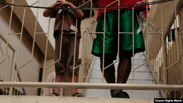 Two asylum-seeking boys stand on a staircase while detained at Belawan Immigration Detention Center, September 2012. (HRW/Kyle Knight photo)