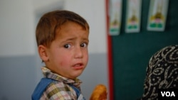 A young Syrian boy looks apprehensive as he awaits a vaccination in Arsal, Lebanon, Sept. 29, 2012. (VOA/J. Neumann)