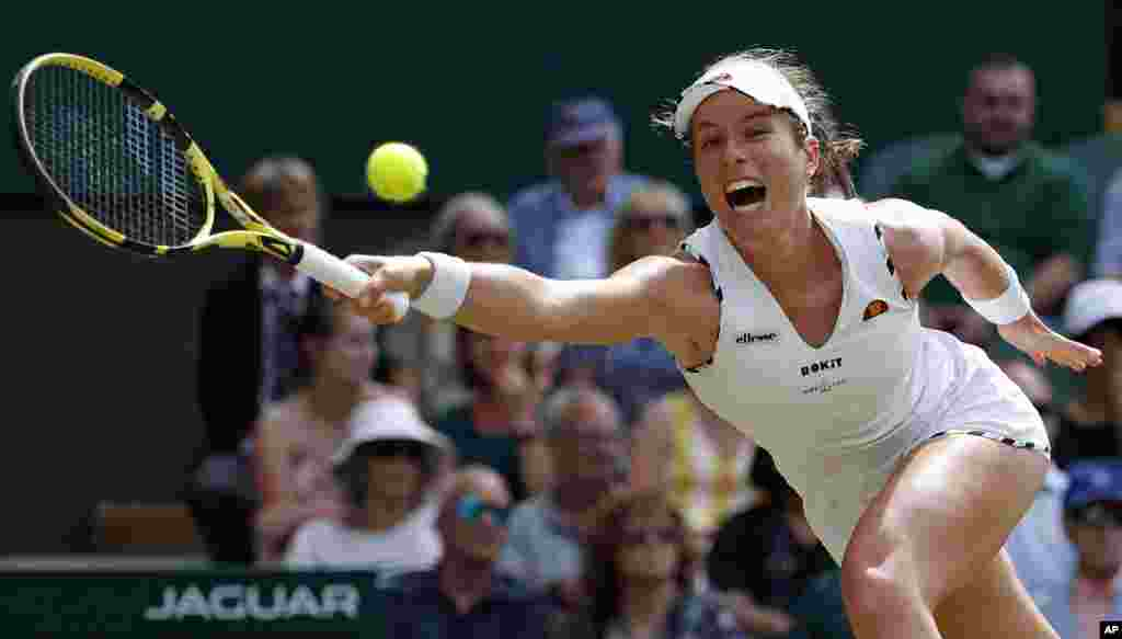 Britain's Johanna Konta returns to Czech Republic's Petra Kvitova in a women's singles match during day seven of the Wimbledon Tennis Championships in London.