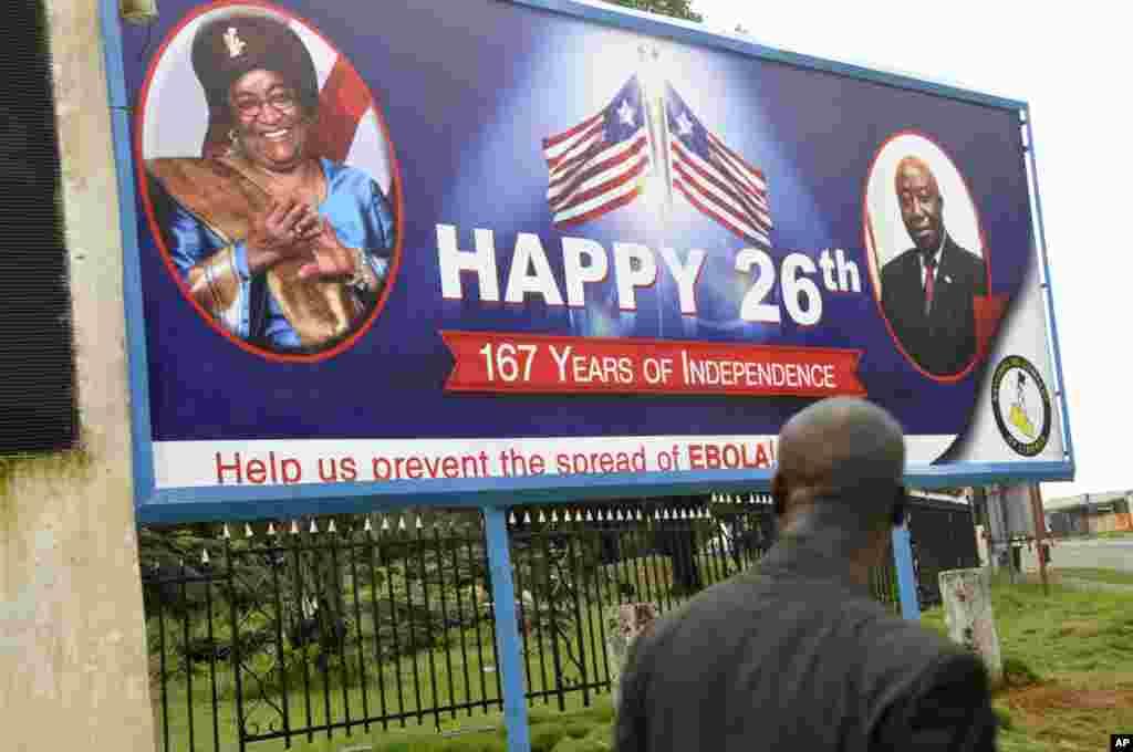 An Ebola public awareness campaign utilitzes a billboard with the face of Liberia President Ellen Johnson Sirleaf, Monrovia, Liberia, July 31, 2014.