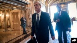Special Counsel Robert Mueller departs after a closed-door meeting with members of the Senate Judiciary Committee about Russian meddling in the election and possible connection to the Trump campaign, at the Capitol in Washington, June 21, 2017.