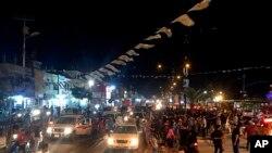 អ្នកគាំទ្រលោក Muqtada al-Sadr ចេញមកសាទរនូវជ័យជម្នះរបស់លោកនៅក្នុងក្រុង Sadr ប្រទេសអ៊ីរ៉ាក់ កាលពីថ្ងៃទី១៤ ខែឧសភា ឆ្នាំ២០១៨។