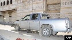 Пошкоджена в результаті атаки машина в столиці Сирії Дамаску