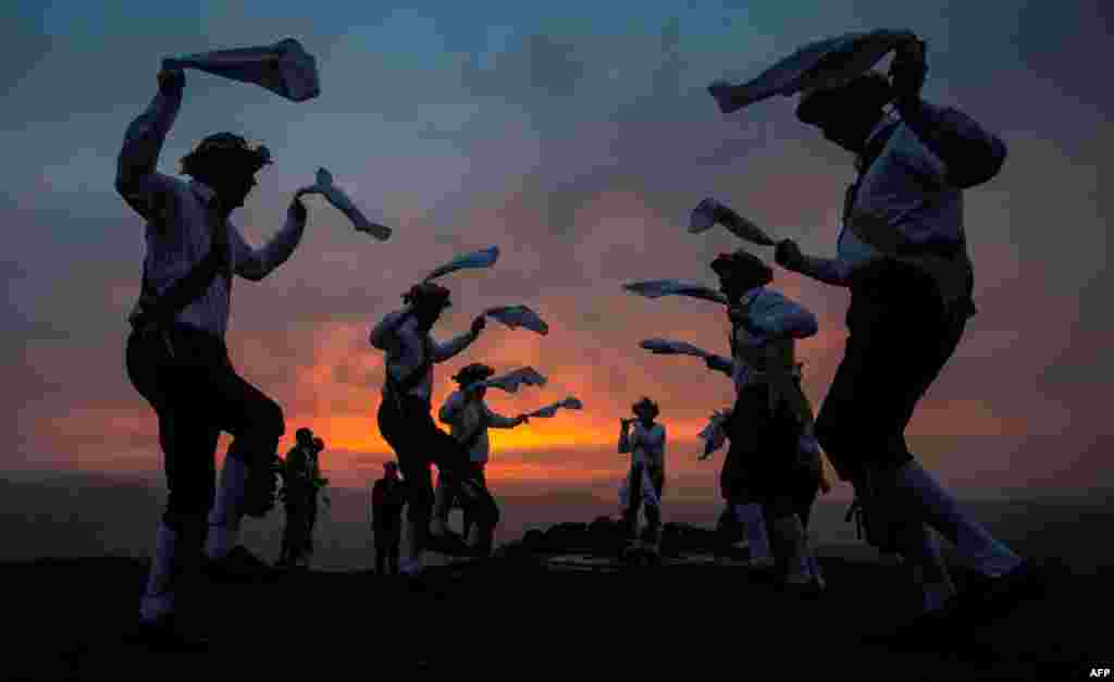 The Chapel-en-le-Frith dancers perform an annual dance atop the Eccles Pike in Derbyshire, Britain, at sunrise, as part of the ancient Celtic festival Beltane, celebrated on May Day or the beginning of summer.