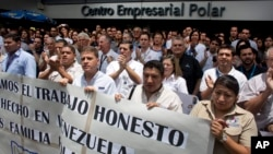 Polar workers who fear losing their jobs protest outside company headquarters in Caracas, Venezuela, Friday, April 22, 2016. Polar, the largest producer of beer in the country, said Thursday the lack of imported raw materials.