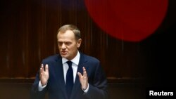 Poland's Prime Minister Donald Tusk gestures as he delivers a speech at parliament in Warsaw, August 27, 2014.