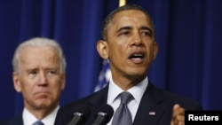 US President Barack Obama (R) unveils a series of proposals to counter gun violence as Vice President Joe Biden looks on during an event at the White House in Washington, in this January 16, 2013, file photo.