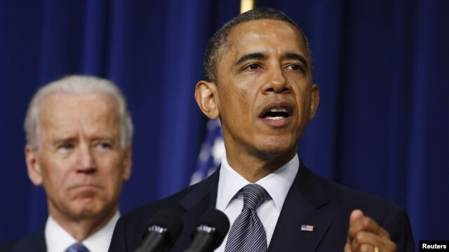 US President Barack Obama (R) unveils a series of proposals to counter gun violence as Vice President Joe Biden looks on during an event at the White House in Washington, January 16, 2013.