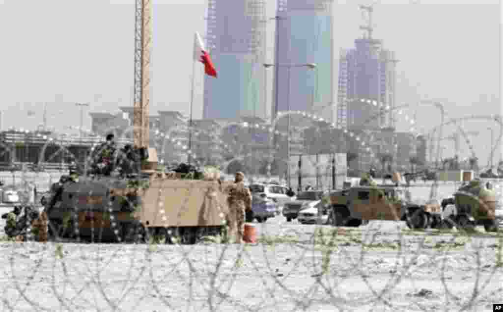 Bahraini army vehicles occupy Pearl Square, behind razor wire in Manama, February 18, 2011. (AP Image)