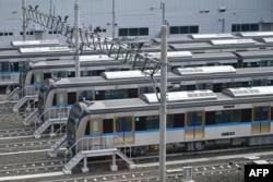 Gerbong-gerbong Moda Raya Terpadu (MRT) Jakarta tampak di stasiun utama, 30 Januari 2019. (Foto: Bayu Ismoyo/AFP)